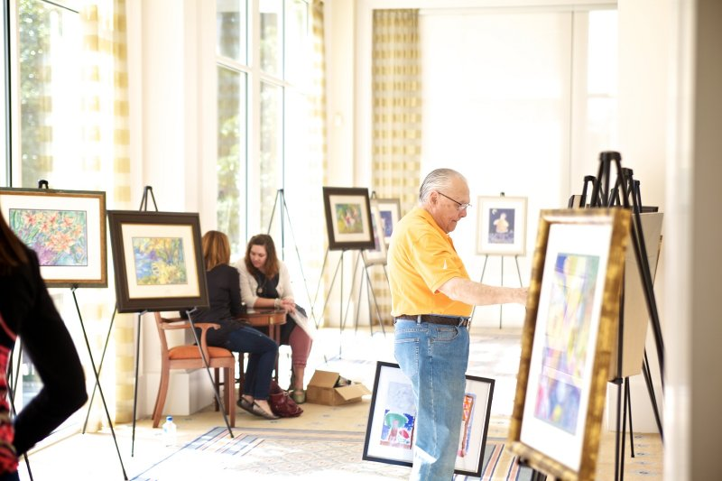 Tom Bledsoe (Board Member) preparing for the Children Art Sale